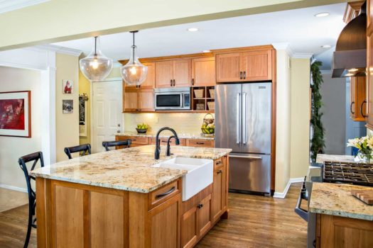 Open kitchen with granite counter tops and stainless steel appliances