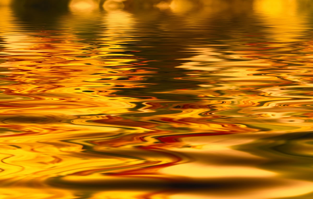 Water reflecting gold and red hues.