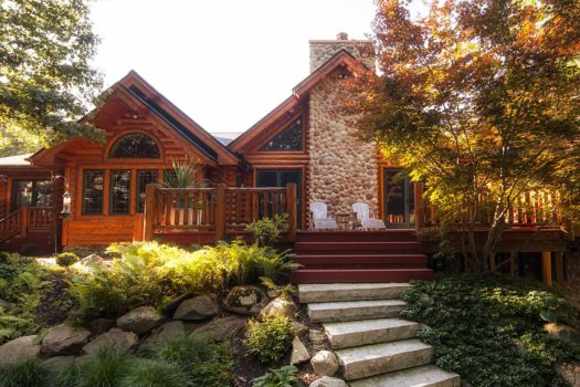 Log home with large deck and landscaped yard